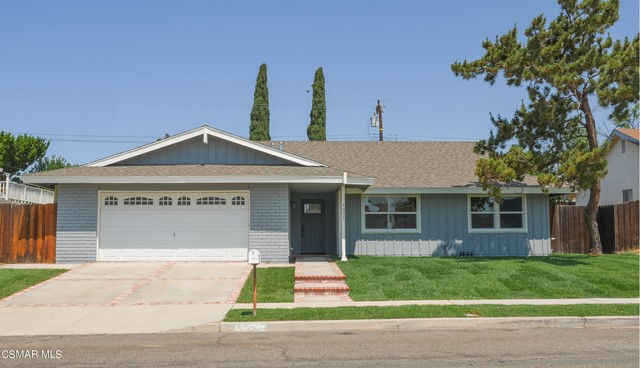 How soon can you Move??? Beautifully remodeled and move-in ready Simi Valley single story with great curb appeal and offering a bright, open floor plan with 3 bedrooms, 2 baths, almost 1500 sq. ft. of comfortable living space on a newly landscaped 7,000 sq. ft. lot with room for a possible pool! Highlighted by wood flooring, recessed lighting, smooth ceilings, dual pane windows, fresh paint, and a cozy fireplace in the living room, a spacious dining area, and a GORGEOUS redone kitchen with soft close cabinets, quartz counters, subway tile backsplash, stainless steel appliances, designer open shelves, and a convenient breakfast area.  The master suite boasts a walk-in closet and a private en-suite remodeled bath with deco tiles, walk-in shower and large vanity. Secondary bedrooms are ample sized and full hall bath has also been redone. Rear grounds offer an expansive wrap around covered patio and manicured grassy area. Additional amenities include: central air & heat, new fixtures and doors, direct access 2 car garage, and so much more! It's a MUST SEE!