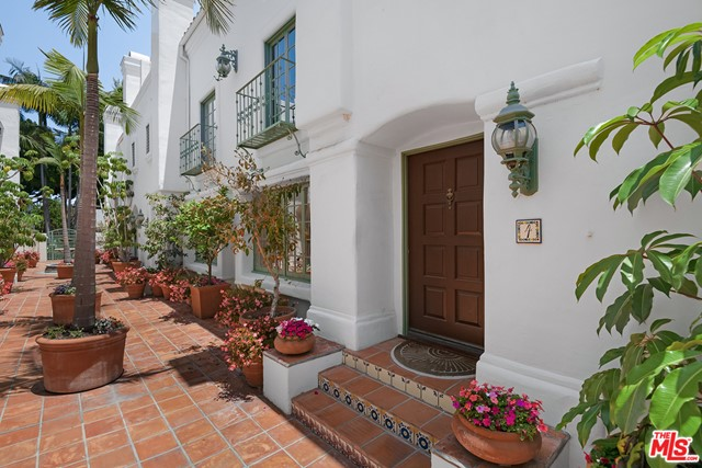 Beautiful Quintas Malaga, a Mediterranean- inspired privately gated complex, in idyllic Santa Monica. This newly renovated 2 bedroom, with en-suite baths (upper level #3 bedroom/den with small closet) 2.5 bath is located near world-renowned beaches, trendy shops on Montana Avenue, award-winning schools, Douglas Park and Whole Foods market. The front courtyard leads you into the unit with an open-concept layout flowing from the living room with a fireplace, to the formal dining and doorway opening onto a patio. The light and bright kitchen features quartz countertops, subway tiled back splash, abundant cabinetry and breakfast area. Chic laminate wood-like flooring creates a contemporary yet warm feeling. Retreat upstairs to the master bedroom, with a fireplace, walk-in closet and private bath offering double sinks, soaking tub and separate shower. The 2nd bedroom includes an updated en-suite bath and a walk-in closet. Convenient laundry area is nearby.  Peek-a-boo ocean views can be enjoyed from one of the 2 decks off of the 3rd floor den/ bedroom with small closet. The unit can be accessed directly through the attached private two-space garage with gated driveway entrance.