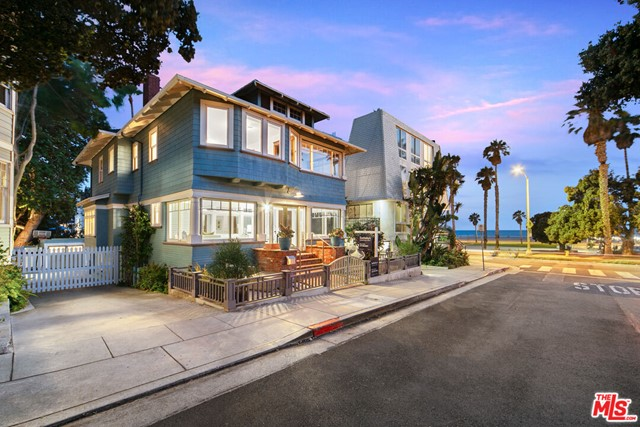 The South Beach District of Santa Monica, consisting of only 5 short, one-way streets originally developed in 1908 that maintains their historical significance and charm to this day. The continuity of this quaint, coastal Santa Monica neighborhood that gently slopes to the beach access and boardwalk offers architectural and historical integrity with gem-colored Craftsman and Queen Anne-style homes. With easy access to the shops and restaurants along Main Street or the sunset views along the adjacent, Santa Monica Beach, this neighborhood exudes a charm, luxury, and lifestyle unrivaled in Los Angeles.  This turn-of-the-century Craftsman home still has the original wood-beamed ceilings, wood fireplace mantle and tile, wood trim, and dark oak floors throughout, this 4 bedroom, (primary and 2 guest rooms upstairs) and 3 bathrooms, and also have separate access, renovated basement (approx 840 sqft, 4th bedroom and 3rd bath, great for rentals or guests or a studio), large rear deck area, detached office space, and outside sitting area, interior elevator, 2 car carport with additional parking, shared security gate, and front porch to enjoy the sunsets towards Point Dume and the Santa Monica Pier.