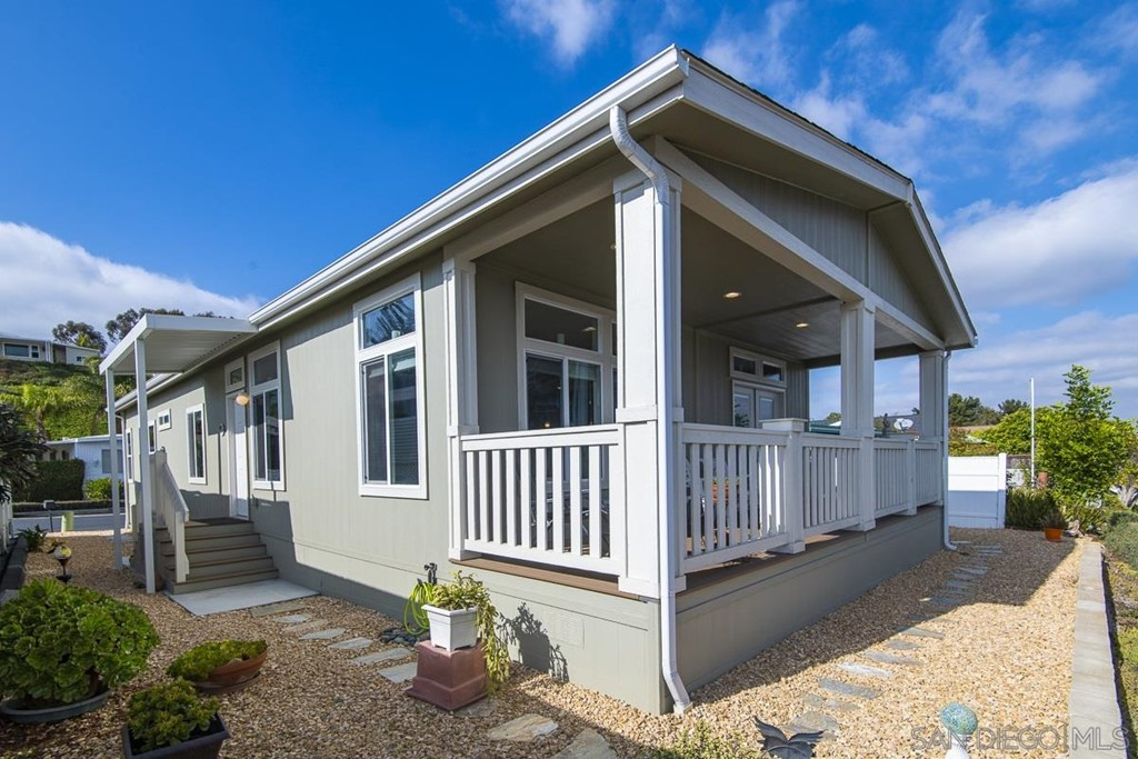 This beautiful single story, 2019 Silvercrest, 3br, 2ba home is perched high on the view side of the hill in the highly desirable, 55+ community of Park Encinitas.  Enjoy the views from the Trax wood rear deck that spans the with of the home.  Remember you own the land at Park Encinitas. NO lot lease and low HOA's.  The new home was placed on the view lot in May 2019 and has high ceilings, wood floors, large door openings to accommodate wheelchairs and the great room concept among some of its features. Complex Features: ,,,, Equipment:  Dryer, Washer Sewer:  Sewer Connected Topography: LL