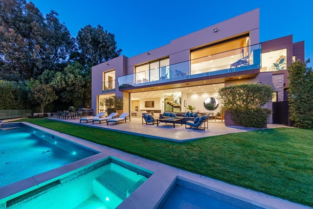 This stunning three-story architectural masterpiece is located on one of the most prestigious streets in Los Angeles. The moment you enter the sweeping glass entryway, you're greeted with panoramic ocean views, which truly makes this home a prized property. The bright six-bedroom home is the epitome of California indoor/outdoor living, boasting sliding glass Fleetwood doors for direct access to the expansive backyard. The top of the line Chef's kitchen features Wolf and Sub Zero appliances, Dekton countertops, and Australian Oak cabinetry. The upper level holds four en-suite bedrooms, including a lavish master, with a grand walk-in closet and an oversized bathroom equipped with a steam shower and a stand-alone bathtub overlooking the ocean. The lower level features a state-of-the-art home theater, gym, fully illuminated onyx bar, temperature-controlled wine cellar, and a Crestron home automation system.