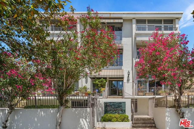 Take advantage of all that Santa Monica has to offer in the historic San Vicente Courtyard District, just north of Montana. This light filled, single level penthouse offers treetop views of San Vicente with a private south facing balcony. Completely remodeled with hardwood floors throughout and a generously sized kitchen. The kitchen conveniently flows into the dining room and is equipped with stainless steel designer appliances and stone countertops. The spacious living room has a fireplace and wet bar with easy access to the balcony, making it a great space for entertaining or relaxing. The central hall floorplan offers three bedrooms, all with loads of natural light. The master has a large walk in closet, gorgeous bathroom with dual vanities. Heated swimming pool & spa and two side by side parking spots in secured garage just a few short blocks to the ocean, dining, shopping & nightlife. Do not miss this rare opportunity!