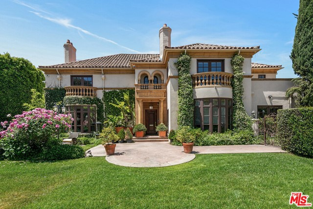 Located on the coveted Hudson Ave, this Mediterranean estate boasts elegance, character, & grand scale. Sitting on an expansive corner lot, the home showcases a custom facade surrounded by lush gardens and mature landscaping providing the utmost privacy. Enter into the grand foyer with a sweeping staircase, wood inlay floors, custom crown molding & french doors. Featuring 6 bedrooms and 8 bathrooms, the home boasts over 8,500sf of quintessential living spaces w/ designer details including custom millwork, ornate crown molding, imported fixtures, & French doors opening up to balconies, verandas, and entertaining areas. Perfect for relaxation and entertainment, the backyard hosts a wraparound grassy yard, large swimmers pool, a spa, various patios, and outdoor dining area.