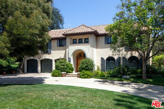 Timeless Mediterranean Estate on a rare dbl lot w/ 220 feet of frontage and over 42,500 square feet of land on coveted S Bristol in prime Brentwood Park. Set behind tall gates w/ extraordinary park-like grounds consisting of mature gardens, expansive lawn, walking paths & sitting areas, lg pond, peaceful stream, fountains, climbing rose covered arbors, oval pool, stone patios and awe-inspiring old growth trees. Dramatic dbl ht foyer leads to superbly proportioned, sun-filled spaces including formal liv & din rms, inviting den, library & lg kitch/fam rm, which all open to the beautiful grounds. There are 4 BR suites incl a sumptuous owner's suite w/ sitting area, FP, pvt terrace overlooking the garden & dual lavish bths & furniture grade closets. With tall clgs, stone & wood flrs, beams, arched openings, 3 FP's & French drs thruout, this home envelops you in quality & charm.  Situated close to town, yet a world away. One of the most spectacular properties in all of BW of Park!