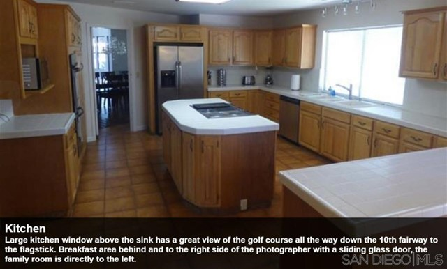 Large kitchen window above the sink has a great view of the golf course all the way down the 10th fairway to the flagstick. Breakfast area behind and to the right side of the photographer with a sliding glass door, the family room is directly to the left.