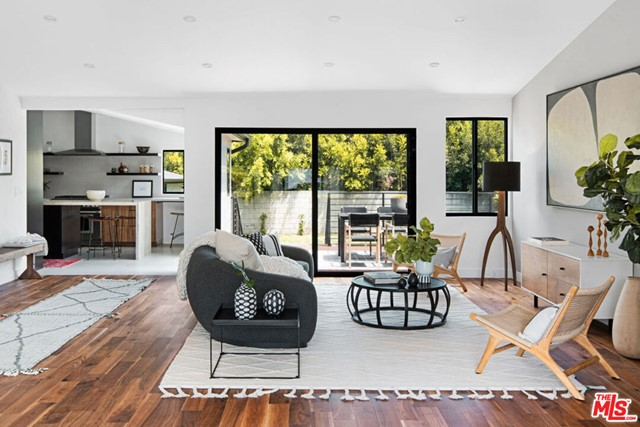 Stunningly remodeled home with a brand new swimming pool/spa and a big, grassy back yard in President's Row - what more could you want? Entertaining is easy here. A wide open floor plan allows for much mixing and mingling, or having a cozy Sunday snuggle. Warm walnut floors, a kitchen any HGTV chef would covet, a back deck spacious enough for dining and lounging... and that pool! A 'studs up' remodel, all of the home's systems are new. The primary bedroom, with a separate entrance to the back yard, has a spacious pass-through closet, and an en suite bath boasting separate vanities, a deep soak tub and walk-in glass shower. Both guest bedrooms have generous closet space and share a spacious jack-n-jill bathroom.  Vaulted ceilings in the main living areas lend a sense of volume, and lots of windows let in lots of natural light. The detached garage is perfect for parking or as additional flex living space. Located just a block off of Abbot Kinney, you're close to all of its shopping and dining,  and getting to the beach for a spectacular sunset is so easy...