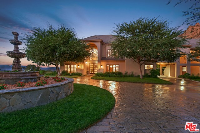Rare opportunity to acquire a custom estate on over four acres of landscaped grounds. The 4755 SF home features dramatic mountain views, privacy, and room to expand for horses. The two story home has 4 bedrooms and 4.5 baths and a large separate guest house above a detached 3 car garage.  There are hardwood floors, four fireplaces, gourmet kitchen with a large center island,  formal dinning room, family room, living room, and lots of natural light. There is a pool and large hardscape deck with custom bbq area perfect for sunset parties. A large orchard with mature fruit trees can be found along a meandering path leading to a vegetable garden and large areas of lawn.  Just minutes to the best restaurants and shops in Westlake and only 7 miles to PCH.