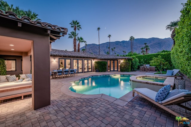 """Location, location, location. AND with a 'noted' celebrity history. This property has it ALL. Location: A prime location within Old Las Palmas, one of the most sought-after neighborhoods of Palm Springs. This property is one block from North Palm Canyon Drive and walkable to the Uptown District, the arts and dining district, and its many restaurants, cafes, coffee shops and retail venues. Celebrity History: Yes, this was Cher's Old Las Palmas Santa Barbara style hideaway according to the Los Angeles Times. The Los Angeles Times reported that Cher owned this property and extensively expanded and remodeled it. Cher said at the time: """"I've always loved the indoor-outdoor lifestyle you find there (in Palm Springs). We designed this home to capture that feeling"""". Her expansive custom architectural remodel redesign nearly doubled the original floor plan of the home, all with """"Cher-style pizazz"""". Property Details: 4,015 square feet, 4 ensuite bedrooms, 4 1/2 bathrooms, media room, gorgeous travertine stone flooring in the great room, kitchen, hallways, laundry room, media room and bathrooms. A voluptuous master suite with Western Mountain views from the multiple French doors that lead to the pool and spa, a fireplace, a coffee/wet bar, two walk-in wardrobe closets and a large master bathroom. Chef's kitchen with premium SS appliances, double ovens, granite countertops, stunning cabinetry, and adjacent walk-in pantry. Large two-car garage with extensive built-in storage cabinetry. Electronic gated auto driveway entrance. Private rear patios with inviting saltwater pool and spa - captivating west-facing mountain views and a perfectly located custom built-in BBQ island complete with a large SS gas grill. Furnishings are available outside of Escrow, per inventory."""