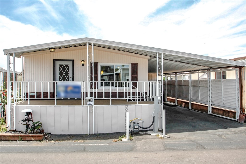 2 Bed 2 Bath Skyline Manufactured Home in El Dorado Park. Great Location w/ access to Palomar College, 78 hwy, Local Stores, & Medical offices. This home has rare open floor plan with Laminate flooring throughout home. Granite Counters, newer cabinets, kitchen island, recessed lighting, tiled bathroom floors with newer vanities. Home was remodeled extensively 2 years ago. Recent addition has been ALL NEW VINYL WINDOWS.... There is a shed for personal workshop at the end of the carport  El Dorado Park has been upgraded over the past 4 years and is set to have roads repaved in the near future. More improvements to come in the future. Park Approval is required with all sales..  Neighborhoods: El Dorado Park Complex Features: ,,, Equipment:  Range/Oven, Shed(s), Water Filtration Other Fees: 730 Sewer:  Sewer Connected, Public Sewer Topography: LL