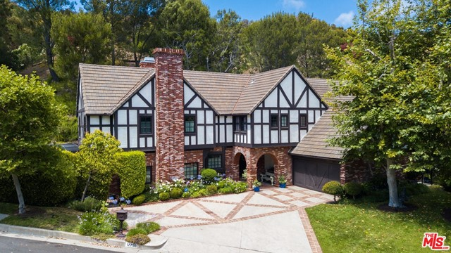 Located in the desirable, 24-hour guard gated, Highlands neighborhood of the Country Estates. Come see this beautiful English Tudor style home, on the market for the first time in 41 years, with features only found in a vintage home like this. It offers open beamed ceilings, hardwood floors, and a distinct pitched roofline. This property provides the new owners the opportunity to restore this lovely classic home back to its pristine glory or modernize the estate to create a home with a traditional Tudor style exterior and modern interior. This gorgeous 4,012 square foot home offers 4 bedrooms upstairs, two offices downstairs, 4 baths and an amazing outside space that lends itself to a spectacular entertaining area. Just over 2 acres, this landscaped, amphitheater-like lot is dressed with an abundance of large mature trees, providing not only privacy, but also natural beauty. Enjoy the very large pool with fountain, spa, built in BBQ & two large decks for sunbathing.