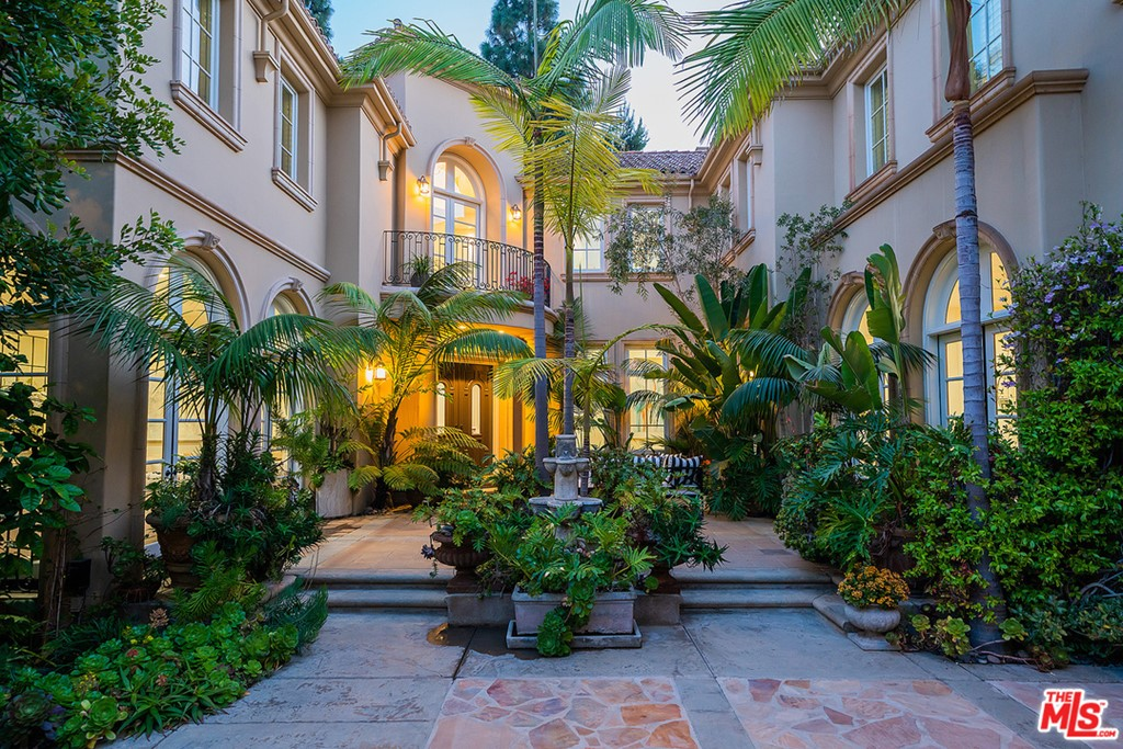 Rare opportunity to own a 8,607 sq ft, 3 story Villa in coveted Century Woods Estates, the most extraordinary residential enclave the world has to offer!  Here, in the heart of a small forest, amidst towering sentinel trees, the romantic fantasy of Southern California reigns again. This guard gated community is a refuge from the city outside.  The waterfall welcomes you to the 2 swimming pools, gym and more in a 9,000 sq ft recreation building & a tennis court. Your Villa in the classic Monterey style of early California architecture is gated and very private with 6 bedrooms, 9 bathrooms, 3 fireplaces and an elevator.  The main level includes living, dining and gathering rooms.  Tremendous cooks gourmet kitchen. Lower level features a wine room, gym,  bed & bath.  The 2nd floor has an amazing primary suite with sumptuous bathroom and luxurious closets.  3 additional large bedroom suites up.  Your courtyard boasts a 3 car garage and a lush entertaining area.  A location like no other. Agents, brokers and sellers make no representation as to square footage. Information was obtained from a third party vendor and buyers are encouraged to investigate on their own.