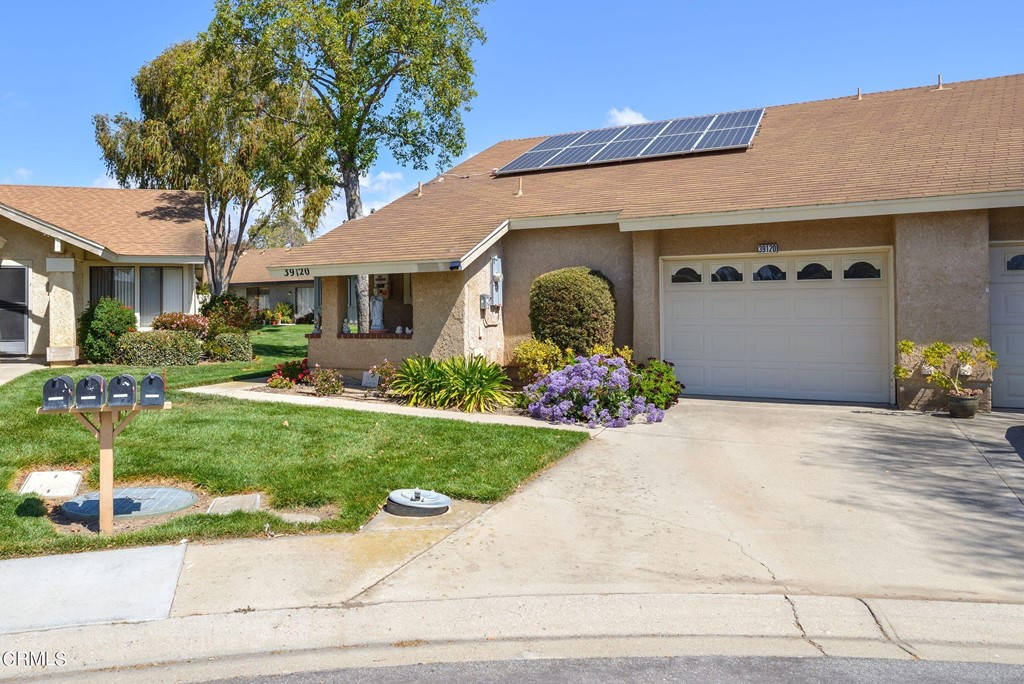 This is the very desirable Holmby II model home in Camarillo's Premier Senior Community, Leisure Village.  This home has an enclosed patio on it that gives you an extra 200 sq ft which is reflected on the home's total living area. This home has solar panels and newer vinyl windows that make the home quite energy efficient. The home has a newer kitchen and updated bathrooms. The bedrooms in this home are large and give you plenty of options for the layout.  The master bedroom has a walk-in closet and double sinks in the bathroom. The laundry is inside in its own room and even the garage is larger than most in this community.  Come see this home.  The current owner was very creative with the extra space from the patio enclosure, come see! You don't have an outdoor seating area but there is room still for the BBQ!