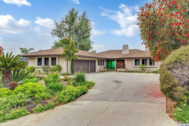 La Canada Schools! Open Floor plan Mid-Century with panoramic views! 3 Large Bedrooms and 3 full bathrooms. 3 car garage and laundry room!