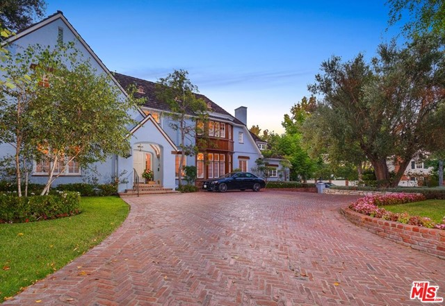 Iconic Country English in the heart of the Beverly Hills on arguably the best street in the flats.  5300 sq. ft. Country English home Reminiscent of the English countryside with grand scale rooms; large formal dining room, large formal living room, wood paneled library, hidden speakeasy Billiards room, garden room, large gourmet kitchen and breakfast room, maids and bath complete the main floor.  Upstairs is a sensational master suite with a large bath and fabulous closet space, 2 additional bedroom suites upstairs.  Fabulous yard with a large pool, outdoor shower, outdoor Dining and pergola with a fireplace, bonus room above the garage all on a 13,677 square foot lot.  Sensational flow for entertaining, true center hall plan, walls for artwork this is old Hollywood glamour at its  finest and all just minutes from Rodeo Drive shopping.  4 bedrooms, 5 1/2 baths