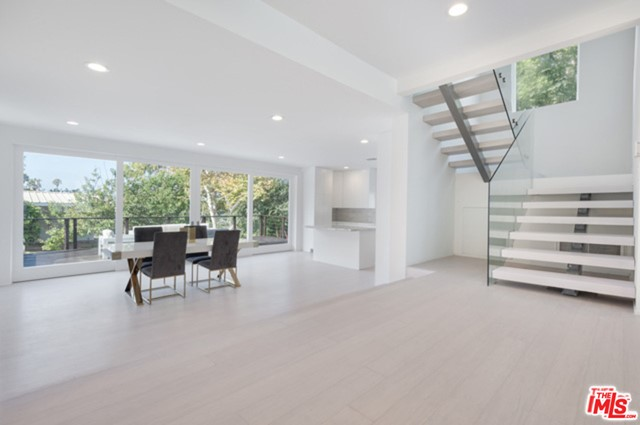 Completely Remodeled with no expense spared in this custom Contemporary home in one of the best neighborhoods in Malibu. Former home was taken down to the studs & now includes all new flooring, kitchen, bathrooms, doors, windows, recessed lighting, plumbing, & new electrical allowing for central heat and air. Featuring an expansive open floor plan with high ceilings, light wood flooring and gorgeous 10 ft wood sliding doors open onto the sprawling 1,000 sq. ft. entertaining deck & private back yard. The brand new chefs kitchen w/ custom cabinetry, marble counters & viking appliances through out opens up to the dining room & outdoor deck. Upstairs is the master suite with ocean views, private ocean view deck, sitting room, his & her bathrooms w/ steam shower & luxurious walk in closet. Downstairs houses three full bedrooms & two bathrooms. Entire property is fenced & lined with ficus trees. Less than half mile from Elementary, Jr. High & High School.