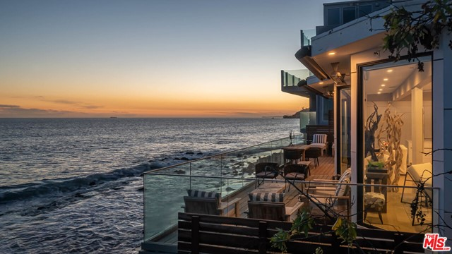 Live the Coastal Lifestyle in this Architectural masterpiece in the heart of Malibu beach. 60 Feet of frontal beach to enjoy and 180 degree views of the Pacific Ocean.. Enter the lush private atrium leading to a ray of light in an open concept living and dining area with french white oak floors and expansive walls of glass. The white and elegant chef's kitchen boasts all Miele appliances with beautiful quartz countertops, with floor to ceiling sliders leading you to the deck's spectacular ocean air. The very spacious master suite features a oversized glass walk in closet. The Master bathroom offers a spa like appeal with an open eggshell bathtub and dual vanities. A second Ipe Wood Deck to enjoy your privacy. 3 additional en suite bedrooms and a bonus ocean front room. Nothing has been spared in this masterpiece smart home featuring all new HVAC, plumbing, appliances, insulation and so much more. Whether it be your beach house or full time residence, you will never get tired of the white serenity and ocean breeze. Just minutes from Santa Monica and Malibu's finest restaurants, this property is a once in a lifetime opportunity.