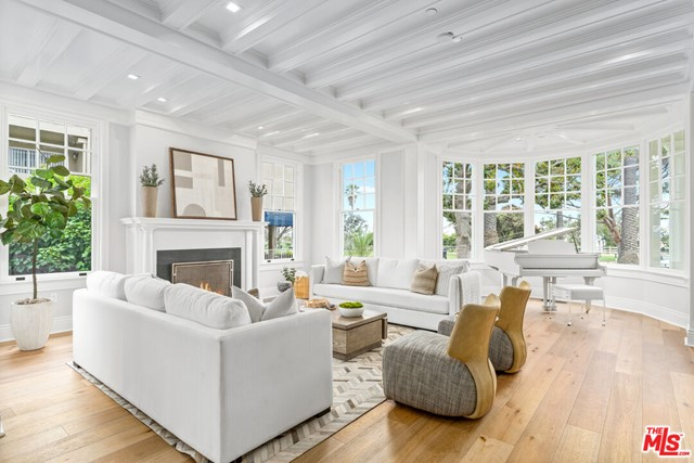 Constructed with appreciation for the past & vision for the future, 401 Ocean offers the opportunity to experience the finest beachside living with an address steeped in California history. Located just off of the Santa Monica Bluffs, this new residence highlights an unobstructed vantage point across the Pacific Ocean while moments from the beach, promenade, & pier. The Landmark Homes sit side by side within the Henry Wyse / Charles Morris House, designed in 1910 by renowned architect & Santa Monica resident Robert D. Farquhar, with a Colonial Revival & Craftsman aesthetic. Every detail crafted with the highest standards exuding luxury while remaining warm & inviting. White oak flooring, custom automated shades, open living space & sizable bedrooms present an elevated ambience while lending themselves perfectly for any interior design aesthetic. The airy kitchen boasts custom two-tone Italian cabinetry from Axis paired with distinct solid stone countertops & high-end appliances from Wolf, Sub-Zero, & Miele. Intricate stone & tile work grace the surfaces & surround luxe fixtures by Brizo, Rohl, Newport Brass, & Toto. This home includes a generous first level patio & spacious second story deck featuring over 1,000 square feet of private outdoor space. Constructed to honor the address history while providing the epitome of first-class ocean-front living!
