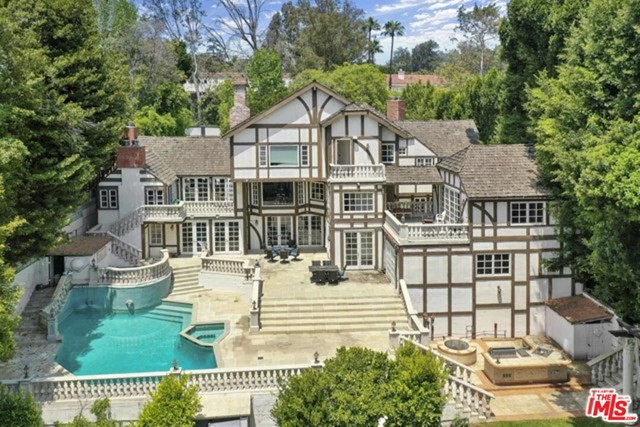An exceptional opportunity to live in this iconic craftsmans estate, once was occupied by legendary Ed McMahon, awaits its next chapter. At 6,741 sqft atop a20,000 sqft lot in prestigious area of Bel Air - little Holmby Hills. The sky's the limit to create a vision with this magnificent property, This property requires a major repairs or updates you can re-build your own or remodel to a new polished look. Surrounded with abundant greenery, open courtyard, amazing pool and a unique custom water fountain to suit your lifestyle. This location truly represent luxury living surrounded by the best of Beverly Hills and Bel-Air where influance and beauty featured throughout.