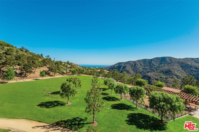 Gorgeous PANORAMIC mountain & canyon VIEWS extend to the ocean from this highly desired Vista Catalina 2,871 SF, 3BD, 3BA + loft home in the Palisades Highlands! Hands down, the BEST LOCATION in Vista Catalina. Enjoy sunlight that streams through the many windows & provides brightness throughout this spacious upgraded home with several VIEW balconies, perfect for enjoying morning coffee & evening dinners. As you enter, you are greeted w/ a beautiful courtyard filled with a wonderful array of plants & flowers. The main level features a spacious primary bedroom suite, formal dining room, a living room with deck access, a laundry room, a powder room & a custom remodeled kitchen with VIEWS, deck access, custom soft close cabinets, Thermadore appliances including a 5-burner range, refrigerator, dishwasher, & double ovens. The beautiful farm sink has Grohe faucets. The kitchen opens to a built-in banquet, a den/office, & a deck with SWEEPING VIEWS. Proceed upstairs to the loft with a huge VIEW deck, 2 additional bedrooms (1BD w/VIEW deck), & a full bathroom with double sinks. The 2-car garage & extra guest parking offer plenty of parking for your guests. Additional upgrades include double-pane windows, newer HVAC (2016), & a newer roof (2017). The community pool & spa offer a resort feel with the Palisades Drive Park just steps away for additional enjoyment.