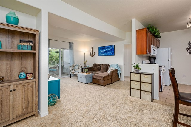 This fantastic Mission Trails condo will check off all the boxes on your wish at a bargain price! 1- Top floor end-unit with only one shared wall. 2- Elevator access with no stairs, 3- Two side-by-side, underground parking spaces. 4- In-unit laundry, 5-Master bedroom with walk-in closet and spacious bathroom. 6-Great layout for enhanced privacy with a bed & bath on each side and living space with a cozy fireplace in the middle. 7- Updated kitchen with granite counters and gas range, 8-See supplement... Neighborhoods: Rancho Mission Trails Other Fees: 0 Sewer:  Sewer Connected Topography: LL