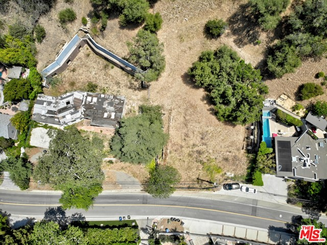 Incredible opportunity to develop for resale or build your dream home on this stunning 1.28 Acre lot in a highly desirable Beverly Hills location. A rare double lot listing with over 55,000 SF combined, offers amazing potential with unlimited options. Two separate APN's allow for either two homes or one large estate. The property located in the heart of Beverly Hills within minutes from Rodeo Drive and the Beverly Hills Hotel.