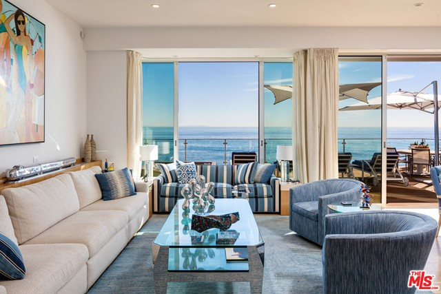 A spectacular modern beach home laden with walls of glass and expansive decks, this 2015 home includes exquisite furnishing and interior design by Tomar Lampert Associates. An amazing great room beckons entertaining with a living area, wet bar, dining area, family room, and Bulthaup kitchen opening up to the large oceanfront deck with in-ground hot tub. The extravagant oceanfront master suite has a large sitting area and fireplace. Enjoy three additional bedroom suites, a third floor with a rooftop deck and fireplace with two additional rooms for either a gym or office, and an elevator to all levels.