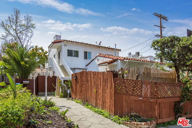 This fourplex has it all; stunning curb appeal, location across the street from the Rancho Park Golf Course, unique floor plans for each unit (three on ground and one upstairs), enclosed patios and parking. The chateau appeal continues inside with hardwood floors, tiled bathrooms and stainless steel appliances. Each unit is a 1BD+1BA. No access to occupied units without accepted offer. Upstairs unit is vacant and has lockban offer.  Each unit also has second access in rear. Westside appreciation, close proximity to future Google campus on Pico and historically low interest rates combine to make this an incredibly appealing trophy property for the real estate investor.