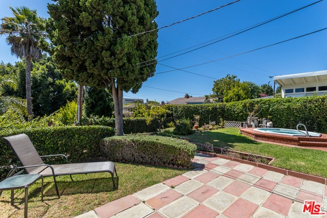 Tucked away on a quiet, peaceful street off the beaten path, sits an adorable two bedroom home with a huge backyard oasis of lush landscaping and gardens, spa, BBQ and sun-lounge area; where you can watch magical sunsets every night. This property is in original condition, with good bones but no cosmetic updates, and has been lovingly owned and maintained by the same family for 50 years. Located in the prestigious Sunset Park area of Santa Monica, it's just a short bike ride away to the beach, pier, promenade and all the many activities that Santa Monica has to offer. You can have it all in this highly sought after location. Attention Investors & Developers: Possible development opportunity. This property is in a prime area with tons of potential. Shown by appointment only.