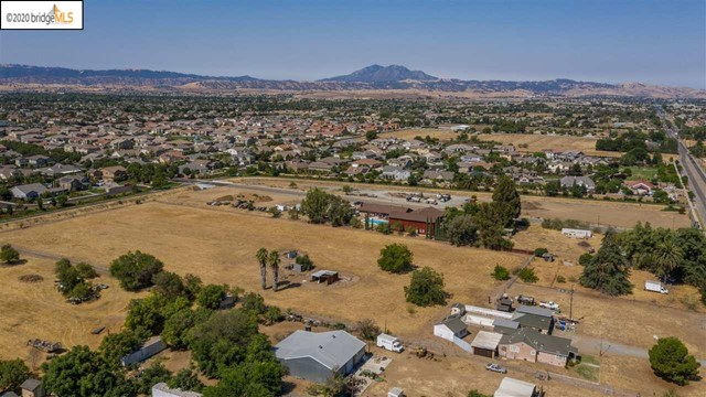 Awesome level 5.61 acre vacant land parcel zoned Residential.  Next door property for sale by same owner. Originally this parcel was an almond orchard using community water for irrigation.  All trees have been removed. No Entry without 24 hour notice.  Tenants on the property. Call listing Broker, Lynnda for appointment.