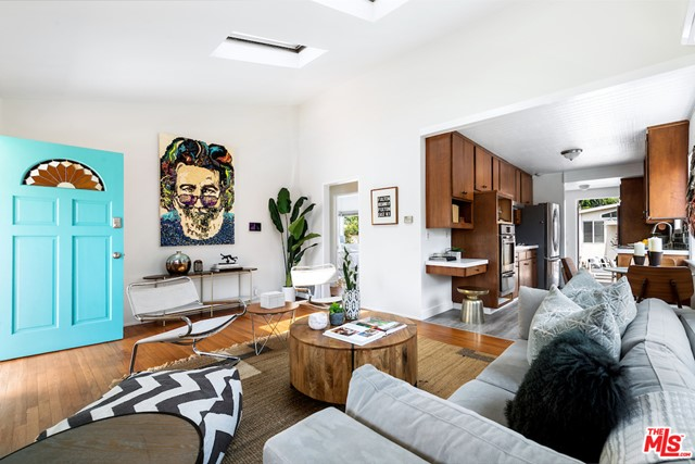 Incredible opportunity to own a prime canals adjacent location! The storybook home of acclaimed artist Laura Kimpton featuring her iconic 'LOVE' word sculpture and original works. This beautiful and enchanting 2bd/1ba traditional is the perfect hideaway for anyone desiring something special and proximity to Abbot Kinney, Washington, Marina and beaches. Updated single story living with ample gated outdoor space as well as a delightful detached creative studio. Work and play from home. There are plenty of outdoor entertainment areas on the large lot over 5,000 sqft. Updates throughout including kitchen, bathroom and two wall A/C units keep this sun-kissed cutie cool in the hot summer. Completely unique and overflowing with warmth and charm. Offering rarity and an unrivaled location, this is the perfect home to further update or develop to your artistic vision. 'All you need is love.'