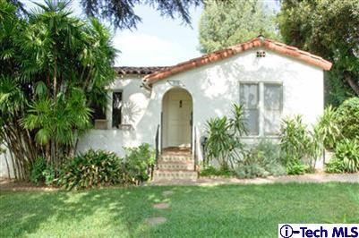 This enchanting Spanish style home with a charming front porch is secluded at the end of a quiet street. Tranquil gardens and peaceful surroundings make this your own private retreat. A spacious floor plan includes two bedrooms, a formal living room with Batchelder fireplace, a formal dining room, beautifully remodeled kitchen with stylish cabinetry and stainless steel counter tops. Additional features include gleaming hardwood floors, central air-conditioning and a one-car detached garage; refrigerator, stove, washer/dryer are included in lease. Pet friendly however additional deposit is required.