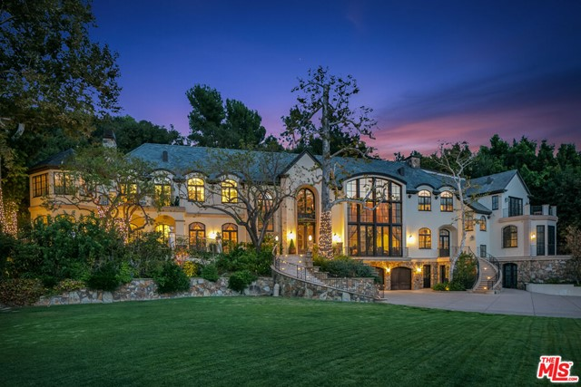 Set on ~2 acres in Beverly Hills, this palatial estate boasts 13,405 square feet of unmatched scale and style. Massive property gates open revealing the tennis court and long driveway leading up to the landscaped motor court in front of the custom facade. Grand front doors open into the 2-story foyer overflowing with natural light. With intricate detail throughout, the home features 7 bedrooms, 9 bathrooms, formal and informal dining rooms, a great room, office, bonus room and bar. Encased by double doors on each side, the living room offers views of the beautiful front and backyard. Exuding luxury, the large master suite encompasses a sitting room and spa-like bathroom. Surrounded by lush greenery, the backyard showcases an aqua pool and spa with a water feature. Extremely private and secure.