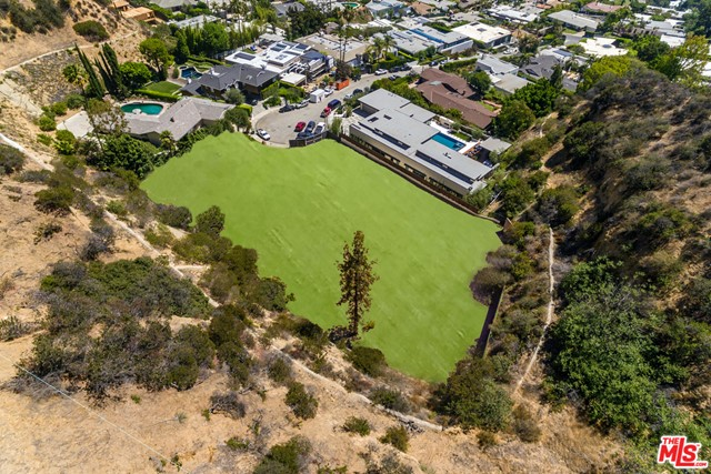 An unparalleled opportunity to own one of the largest/flattest lots in the Bird Streets, two consecutive parcels totaling 1.3 Acres of park-like grounds atop Doheny Estates. Sited at the end of a trophy cul-de-sac, this lot has the rare zoning ability to build two stories above natural grade allowing the potential to unlock incredible city to ocean views. A serene setting surrounded by mature trees, giving one the potential to create a retreat-like oasis minutes from Sunset and Doheny. Conceptual Design for an approximately 11,000 SQFT home by Plus Design Studio.
