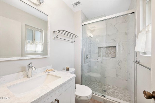 Marble and glass master bath