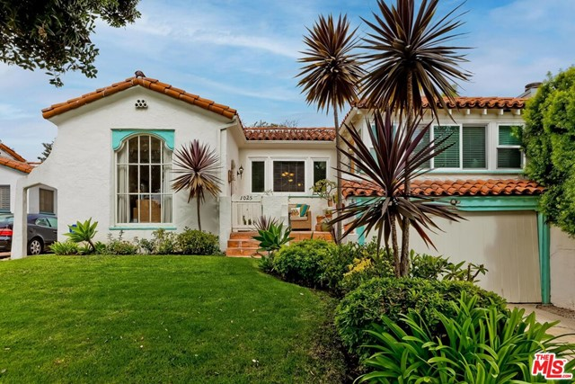 Living the dream! Bike to the beach! Enjoy trendy new restaurants! Marvel at good public schools! Easy access freeways! Whole Foods just a few blocks away! A special property in a lovely Santa Monica neighborhood, this1927 Spanish offers the charm of that era with the upgrades of a lovingly maintained home. Inviting front courtyard leads into a beautiful living room, huge arched window and fireplace; Step up to the formal dining room with so much natural light! Bright white kitchen has a cozy breakfast room, laundry area and side door to the grassy rear yard.  Two spacious bedrooms lead off the center hallway and adjacent to a beautiful full bathroom. There is also an additional guest room/home office area that has a separate entrance from the front courtyard. Beautiful hardwood floors throughout, authentic features and some fixtures. The private rear yard and lush foliage are great for outdoor entertaining, installing children's play equipment, or dreaming of a future remodel.  1545 sq ft on a 5133 sq ft lot. A lovely home in Santa Monica!