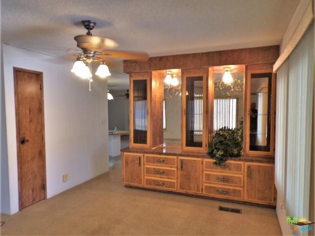 e Warm Wood Tones Shine In e Dining Area Wi Built-in Hutch