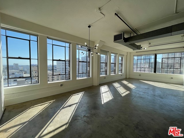 Bright, sun filled, south and west facing, corner loft in the heart of the Fashion District at the historic Textile Building. Giant industrial sized windows showcase the views from Downtown to Long Beach! Concrete floors and high ceilings accentuate this authentic loft. Extra wide dedicated parking space. Santee Village amenities include gym, rooftop pool, rooftop spa, basketball court, golf driving practice and more. All steps from everything that DTLA has to offer. Welcome home!