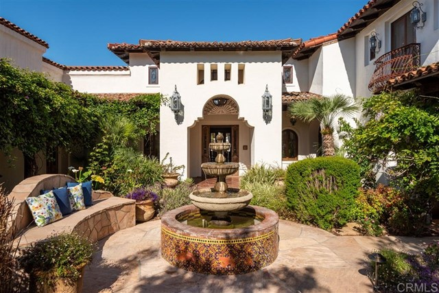 """Stunning Spanish Moroccan, hacienda style estate located in the historical Olivenhain area of Encinitas, adjacent to the areas most popular horse trails. A true """"Entertainers Delight"""" and multi-generational, the home was originally built as a Wellness Retreat and has since been converted into an expansive, single-family residence. Currently an 8 bedroom (suites), 18 bath home, this 16,330 sq. ft. custom estate has gorgeous features with a private place for everyone in your family or business needs. EnterStunning Spanish Moroccan, hacienda style estate located in the historical Olivenhain area of Encinitas, adjacent to the areas most popular horse trails. A true """"Entertainers Delight"""" and multi-generational, the home was originally built as a Wellness Retreat and has since been converted into an expansive, single-family residence. Currently an 8 bedroom (suites), 18 bath home, this 16,330 sq. ft. custom estate has gorgeous features with a private place for everyone in your family or business needs. Enter through the private gates into one of the most unique and stunning Spanish/Moroccan hacienda style estates located in the historical Olivenhain area of Encinitas, adjacent to the areas most popular horse trails. A true Entertainers Delight, the home was originally built as a Wellness Retreat and has since been converted into an expansive, single-family residence. Perfect for large and extended families, there is a place for everyone in this home. Currently an 8 Bedroom (Suites), 18 Bath home this unique and luxurious, one-of-a-kind, 16,330 sq. ft. custom estate offers large families endless possibilities. Every bedroom in the home has been converted into suites (or mini-apartments) that include a bedroom, a living room and a dressing area, along with up to two full bathrooms. Additionally, one of the suites is a granny suite and includes a full kitchen, 2 bedrooms, living room, and 3 bathrooms. Because of the unique nature of the Suites, there is a potential for rent"""