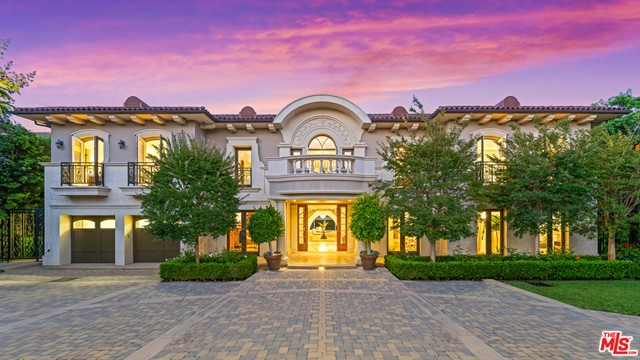 Set on one of the most coveted streets in Brentwood Park, stands this striking custom-built estate. A stunning grand foyer with soaring 20ft ceilings and a dramatic dual staircase that sets the tone from the moment you enter the home. A gourmet kitchen built around the art of entertaining with high-end stainless-steel appliances, tons of counter space, custom cabinetry & a 120 SF island that overlooks the park-like grounds. An oversized royal living room w/ pocket doors that opens to the private patios. Highlighting 7 generous suites, 9 baths including a luxurious presidential suite with a sitting area, large balcony, two walk-in closets and a spa-like bath that rivals any 5-star resort. A wood paneled office with private entrance, an oversized media room, family room with full custom bar, and a private dining room that can accommodate seating for over 20. With custom details at every turn this home exudes elegance & panache. The ultra-private backyard  set on over a 29K SF lot, features an infinity edge pool w/ private cabana, an outdoor kitchen w/ a built-in grill & a large grassy area great for entertaining all year round. This is truly a one-of-a-kind estate built around the art of entertaining with privacy and luxury details not often seen.