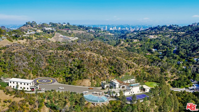 Project 1951...An almost 5 acre development site in prime Bel Air, offering a rare opportunity to build a single-family compound on this private mountain top. The property has undergone extensive infrastructure improvements with caissons and retaining walls already in place. The iconic hilltop property hovers high above the city, offering unobstructed views in this world class location. This developer's dream has unlimited potential. Situated amongst celebrity estates and just moments away from the iconic Bel Air Hotel, this is truly a once-in-a-lifetime opportunity that will never be seen again.