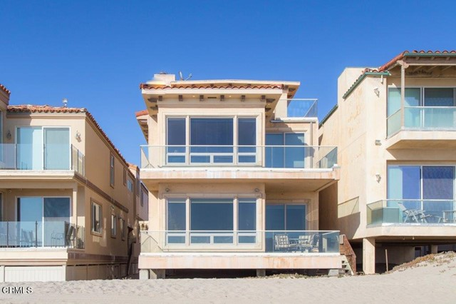 This custom oceanfront is 4,792 sq. ft of magical beach living! This beach masterpiece has 5 bedrooms & 6 bathrooms. The stunning entry welcomes you into a grand foyer which opens to an expansive open concept living area that flows seamlessly between the gourmet kitchen, dining room, wet bar & living room where a cozy fireplace warms the room & walls of glass maximize light & provide endless views. Beautiful travertine floors enhance the spacious floor plan while the ceilings are detailed w/gorgeous beams. Enjoy a true chef's kitchen featuring a huge island, high-end appliances, breakfast bar, granite counters, and ample custom cabinets. A cozy deck off the main room is perfect for dining, relaxation or sunset watching. Follow the dramatic spiral staircase to the next level where a divine owner's retreat w/fireplace & luxurious spa bathroom await. Sunset watching is perfect through the walls of glass or on the private master deck.  Combining simplicity, serenity, & unfailing beauty this sandcastle is of exceptional quality & character.   Lets not forget the FOUR car garage!!!!  With toes in the sand on one of Ventura County's most desirable beaches.