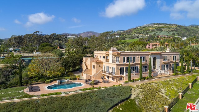 Enjoy stunning ocean views from this privately gated Italian Villa within a gated street. It is beautifully designed with attention to detail and features over 9000' of elegance. There is a gorgeous grand entry with a sweeping staircase. The ballroom sized living room with beautiful ocean views includes a fireplace, lovely arched doorways, custom designed wood and travertine floor plus access to the ocean view veranda. The elegant formal dining room features beautiful ocean views.  A recently remodeled gourmet kitchen features a center island design with stone counters, top of the line stainless appliances and opens to the family room with prime ocean views, fireplace and access to an inviting pool/spa retreat and fire pit. The beautifully designed pool features two fire pits placed on each side of the spa.  There is plenty of room for lounging, entertaining and enjoying the fabulous ocean views.  The exquisite relaxing primary suite includes dual bathrooms, large dual walk-in custom closets, fireplace and sitting area, all with amazing ocean views. Four additional ensuite bedrooms complete the upper level.  Each bedroom opens to the outdoors with balconies. The main level also includes a library, ensuite guest bedroom plus an additional guest suite or staff quarters. The lower level spacious media/game room with bathroom opens to the pool and patio area. Privately gated there is a large motor court.  An ample garage is a car collector's dream with space for apx 8-10 cars, possibly more with the addition of lifts. New septic system and landscaping.  First showings on 9/5. Agents see private remarks.