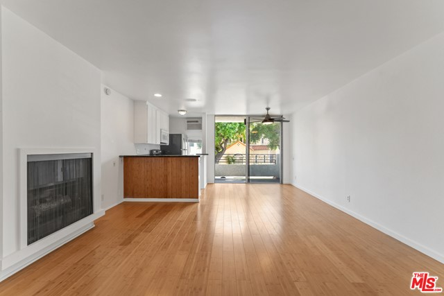 Step into this bright and airy unit in Museum Square/Miracle Mile! Entertain your friends and family in the spacious living and dining areas that flow seamlessly into the open kitchen with and oversized balcony overlooking the hilly treetops. The bedroom features an en-suite bathroom & 2 closets. This sought-after building includes amenities such as a rooftop sun deck with a newly-refinished pool and panorama views of the hills and cityscape, elevator and a laundry room on each floor. Enjoy the convenience of 1 dedicated parking space in a gated community garage. Just a stone throw's away from The Grove, LACMA, the soon-to-be Academy Museum of Motion Pictures, and your pick of trendy shops and eateries. HOA dues include water, trash, maintenance of common areas, building insurance, hot water.