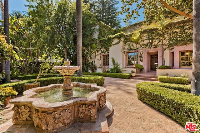 Italian Renaissance estate in exclusive N of San Vicente location. Substantially remodeled in 1989 and expanded to approximately 4,827 sq ft on a 9,960 sq ft lot. Five large bedrooms (alternate uses may serve as office, media room, fitness studio) with 11' ceilings throughout and 12' ceilings in the master bedroom and study. Four bathrooms (1 - full, 3 - 3/4 bathroom). Meticulously cared for and maintained by one owner for over 30 years. Exquisite park-like garden setting - front and rear - with three fountains. Incredible indoor-outdoor flow through seven French doors leading to yard. Entertainers delight - built-in kitchen appliances, double ovens, BBQ, subterranean wine cellar, and dry bar. Stately master suite with views of the Santa Monica Mountains, fireplace, and generously sized walk-in closets. Spacious guest suite with en suite, dual closets, and private balcony. Three balconies with mountain and San Vicente views. Hand-cut Cantera stone adorns the property throughout. Circular driveway with drive-through and pedestrian gates provides utmost privacy. Finished garage includes a 220 volt EV charger. Mudroom and separate W/D room. Plumbed and wired for natural gas generator.