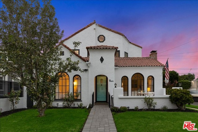 A fully renovated Spanish style home in the highly sought after President's Row in Venice Beach. Open floor plan with 20 foot vaulted ceilings offers beautiful natural light and showcases this home's original charm and details it's fully modernized amenities. You are greeted through the main entry by a spacious living room and joining chefs kitchen that is accentuated with fully custom Quartz Caesar stone countertops surrounding a center island that was designed with ample storage to give the sleek modern look while being fully functional. Enjoy the perks of California living with an inviting backyard perfect for entertaining with it's endless possibilities for indoor/outdoor usage. As you head upstairs you are welcomed by yet another large living space with picturesque windows, vaulted ceilings, a fireplace and a balcony overlooking the marvelous back yard. Bathrooms are newly remodeled with walk-in rain showers and all modern fixtures. Just blocks from the beach yet tucked away on a corner lot in a quiet neighborhood gives this home that peaceful feel while still being walking distance to the Venice Canals, steps from trendy Abbot Kinney and the best eating and dining on the Westside.