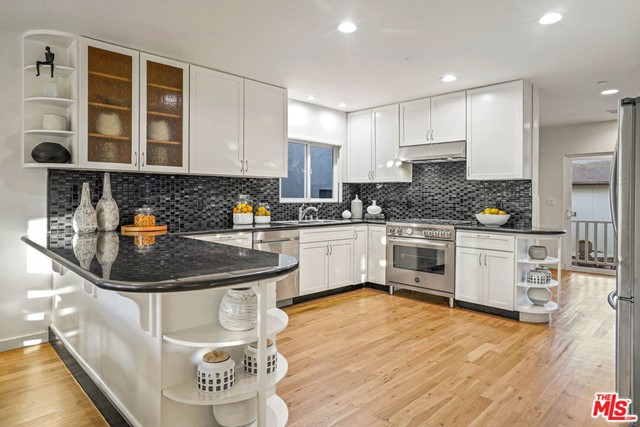 Just reduced 100K! 614 Flower Ave. Venice CA 90291. Two homes on a large 5,793 sq/ft lot. Beautifully renovated Craftsman, approx. 2,780 sq/ft, rooftop deck, private balcony off the master, wrap around front porch off sun room, wood floors throughout, open floor plan, light and bright. Freshly painted inside and out, floors refinished, new range, hood and landscaping. This unique property features the front house w/4 bedroom, 3 bath single family home with a chef's kitchen and entertainer's space. Great indoor/outdoor flow. Beautifully landscaped courtyard separates the main house and carriage house. A two bedroom, one bath private residence. Property backs to alley allowing parking in the front drive as well as the rear within the gate. This is a great opportunity to purchase a move-in, work from home or lease for additional income in this A+ location. Close proximity to Rose Avenue shops and restaurants. This home will not disappoint.