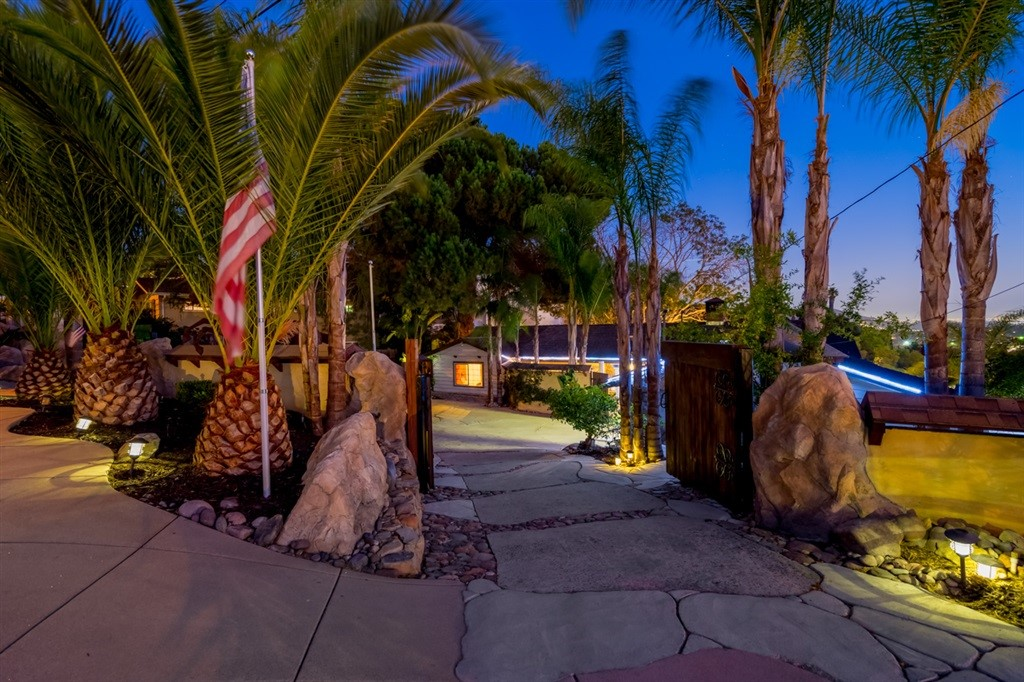 Mt Helix Entertainer's Dream with views to the ocean. Exclusive executive home with with matching Bosch Appliances - Double Oven, Convection Microwave, Built In Espresso maker and refrigerator. Wine Cellar just behind the kitchen with Travertine flooring, Sub Zero freezer and additional Bosch Refrigerator. Wine tasting room at the other end of the home with water feature. 18 ft high ceilings in living room with amazing views. Several patio areas outside including private Jacuzzi and Sauna. See Supplement.  A truly spectacular home designed around Entertaining and the San Diego Lifestyle with over 300k in upgrades. The owners have hosted many parties with over 100 guests. Gated front entrance with parking area for guest outside of gate. Plenty of parking inside the gated area. Private courtyard area as you approach the front door with fountain. Inside you will find 2 fireplaces, a wet bar, spacious dining and kitchen area with high end matching Bosch appliances. The kitchen boasts a Double oven plus convection microwave and a built in espresso maker ! Not only do you have a nice Bosch refrigerator in the kitchen, you have a second Bosch Refrigerator and Sub Zero freezer in the Wine Cellar located just behind the pantry doors. The Wine Cellar can be used as a second dining area, man cave or whatever you can imagine. The dining room / living room has its own fireplace. The family / great room boast views from expansive windows, has a full sized bar and cozy fireplace and gathering area. There is a second wine cellar / wine tasting room with a water feature. The Master suite includes and well appointed bathroom with travertine and a spacious closet to suit just about any wardrobe. Outside you will several patio areas with views out to the ocean and multiple water features including a pool size pond and the lower level. The property has been planted with a vineyard which includes 11 Organic Napa Merlot Vines and several fruit trees - Mango, Persimmon, Apricot, Peach, ...