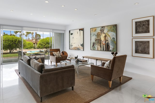 Rare opportunity to purchase a magnificent Mid-Century condo at Canyon Colony West in South Palm Springs. This remodeled condo features a generously proportioned great room with walls of glass opening to a large covered patio overlooking the sparkling pool, spa and wonderful mountain views. Large master-suite includes great closet space and also features a glass slider to the covered patio. Spacious guest bedroom and guest bath with sunken tub. The den/office includes a wet bar and 3rd bathroom. Excellent storage throughout, laundry area and direct 2-car garage. This is a wonderful lock-up-and-go vacation home or ideal full-time residence.