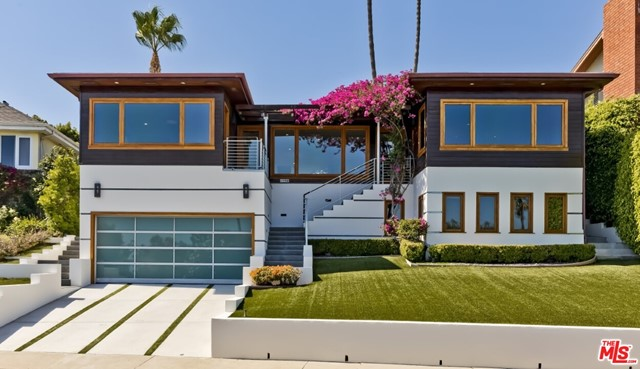 Offered both furnished ($12,500/mo) and unfurnished ($11,500/mo) -- this Architectural mid-century gem reimagined by renowned Hollywood elite architect Frank Israel offers an abundance of natural light. Located on a quiet cul-de-sac facing rows of hedges/Palm trees. Ascend the steps to an immensely open floorplan -- all enjoying the panoramic ocean views. A diagonally positioned fireplace highlights the living and family rooms off dining area. The well-equipped center-island kitchen boasts Italian cabinetry, river rock granite counters, textured stainless steel, soft-close drawers and more. Hardwood and tile floors throughout. Beautiful tilework in the bathrooms. The main/upper level includes 3 bedrooms, 2.5 baths, kitchen, living/dining/family rooms + laundry room. The lower/street level completes the house with a bedrooms suite and 2-car garage. Wonderfully serene yard with open spaces and covered cabana with ocean view through the windows of the house. Available July 15th for 1 year.