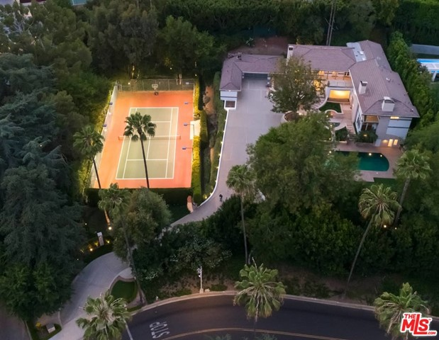 Located in the most coveted North of Sunset area in Beverly Hills, This magnificent gated property sits on over an acre of land consisting of 2 separate parcels. APN: 4350-013-016 and APN: 4350-013-017.  The main residence features generous, light-filled living spaces, including an expansive family/media room with a bar, fireplace, and temperature-controlled wine room; chef's eat-in kitchen; formal dining room; staff quarters, guest quarters and an elevator with direct entry into the primary suite. French doors open to the outdoor terrace from all the upstairs bedrooms. This extremely private serene property is great for entertaining and hosting events.   The sprawling grounds feature a 3-car garage, motor court, a pool with water and fire features, guest house, as well as a fully-hedged and lighted N/S tennis court.